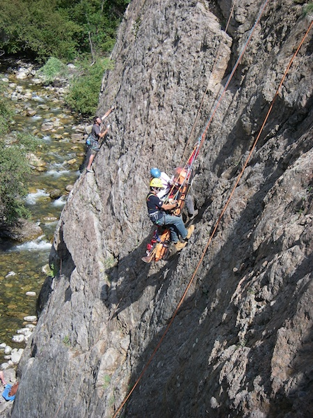 rescue team climbing rockface