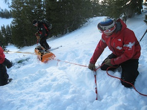 Person helping with an avalanche rescue