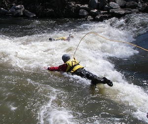 Person rescuing someone in a river